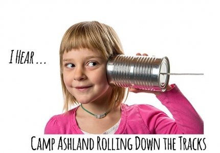 Young girl listening to tin can / string phone.  Isolated against white background.  Copy space to left.